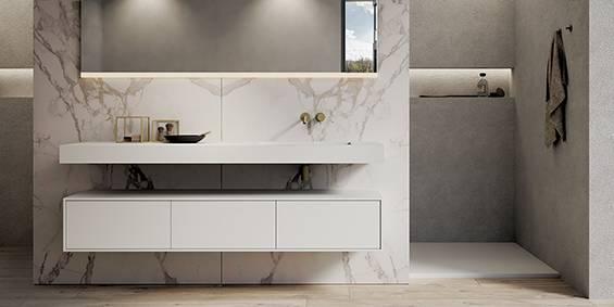 Luxe design badkamers van B DUTCH. Luxe badkamers compleet programma design badkamer elementen. Badkamer inspiratie opdoen? Bezoek de fabrieksshowroom, badkamer showroom, van BDUTCH in Cuijk. Badkamer ontwerpen, badkamer inspiraties opdoen. Dit Solid Surface Corian Hi-Macs ligbad mat wit en de RVS vrijstaande badkamer kranen zijn mooie voorbeelden uit onze eigen B DUTCH collectie badkamer elementen voor tijdloze interieurs. Badkamermeubelen op maat, wastafels op maat. Corian verwerker.